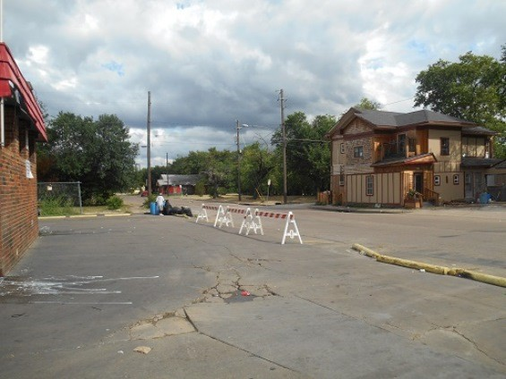 Jim Schutze Police barricades block entrance to the Davenports' car wash, which the city wants to drive out of business.