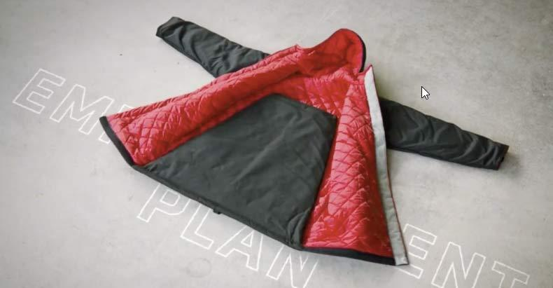 The EMPWR Coat with the sleeping bag folded up in the back