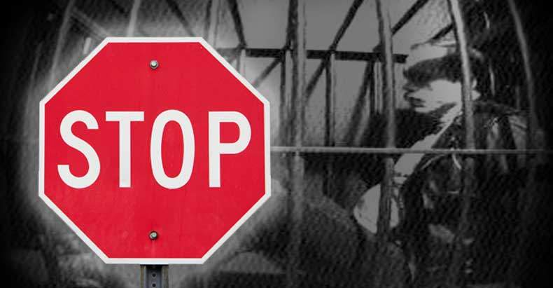man-locked-in-a-cage-urinated-on-by-cops-for-stop-sign