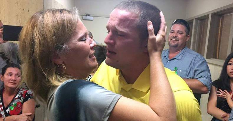 Kyler Carricker and his mother embrace after the jury read the verdict.