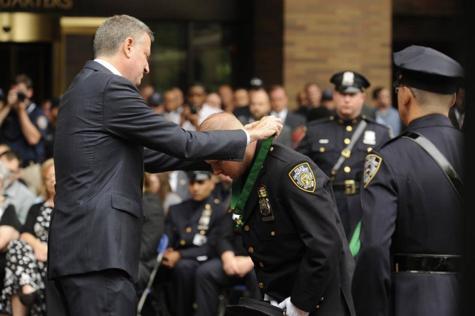 Shortly after NYPD Officer Eugene Donnelly donned his dress blues for a medal ceremony at One Police Plaza, the cockeyed cop sported only his underwear when found in a stranger's Bronx apartment.