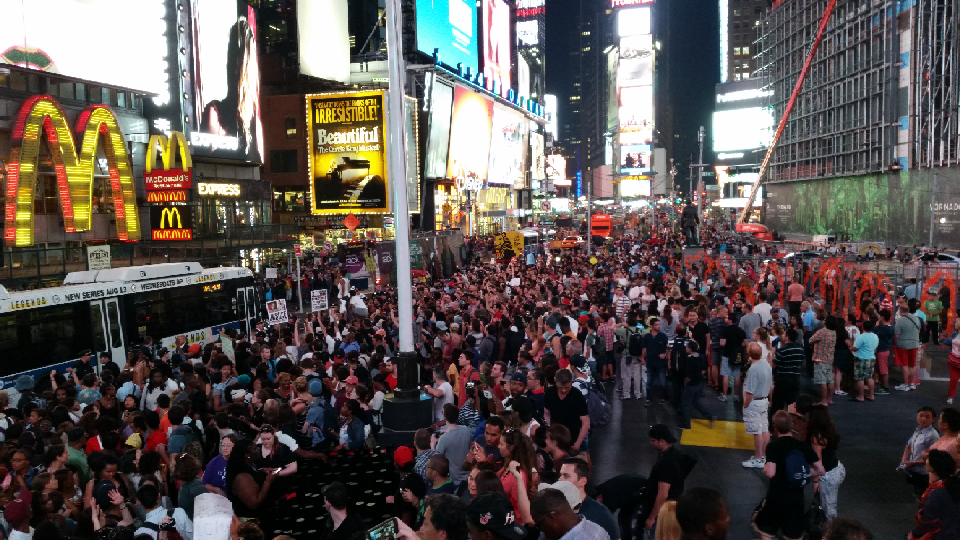 Thousands gather in NYC voice their opposition to police tactics in Ferguson.
