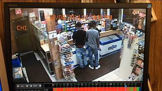 This image was voluntarily released by the owner of the Shaw Market in South St. Louis. VonDerrit Myers is on the left in the black t-shirt. The time stamp says 7:03 PM. Myers and his friends left at 7:05pm.